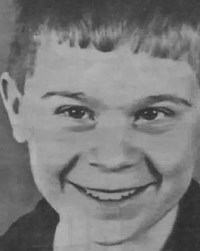 Black and white photo of Jason Dawes, a smiling boy.