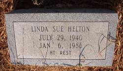 A gravestone. It reads: Linda Sue Helton, July 29, 1940 to January 6, 1986. At rest.