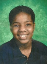 Photo of Leosha Barnett, a young woman.