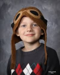 Photo of London McCabe, wearing a teddy-bear hat.