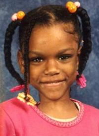 Photo of Markea Blakely-Berry, a girl of about eight years old, wearing pigtails.