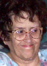 Photo of Criste Reimer, a middle-aged woman wearing glasses.