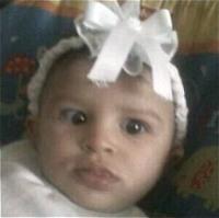 Photo of Nathalyz Rivera, a baby wearing a white hair ribbon.