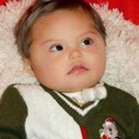 Photo of Lucas Ruiz, an infant lying on a fleece throw.