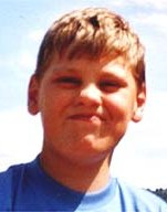 Photo of Ryan Davies, a boy with brown hair, squinting a little in bright sunlight.