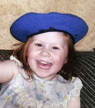 Photo of Shellay Ward, a young girl wearing a big blue beanie hat and a broad smile.