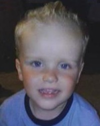 Photo of Aidan Archer, a toddler with blue eyes and blond hair.