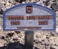 "A temporary plaque marking a grave: ""Amanda Lois Bates, 1987-2001."""