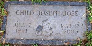 "A gravestone for ""Child Joseph Jose. July 7, 1991 to March 7, 2000."""