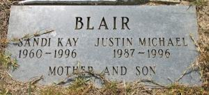 Photo of a gravestone. It reads: Blair, Sandi Kay, 1960-1996. Justin Michael, 1987-1996. Mother and son.