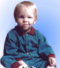 Photo of Alex Boucher, a toddler in a denim outfit.