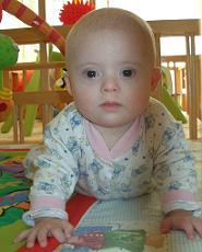 Photo of Nicolai Emelyantsev, a solemn infant in pajamas.