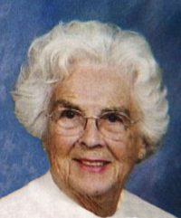 Portrait photo of Betty Erickson, a white-haired elderly woman.