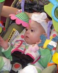 Photo of Madison Garcia, a baby strapped into a car seat.