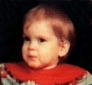 A photo of Tausha Lanham, a toddler with fine ginger hair.