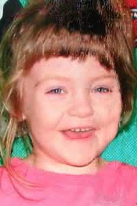Photo of Raelynn Mascal, a girl with messy brown hair and blue eyes.