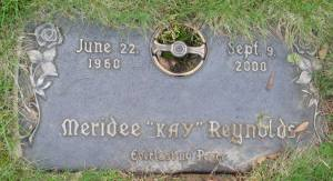 "A gravestone reading, ""Meridee Kay Reynolds. Everlasting peace."""