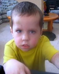 Photo of Jason Rimer, a boy in a yellow T-shirt with a confused expression on his face.