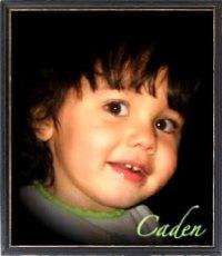 Vignette photo of Caden Rivera, a toddler boy with wavy brown hair.