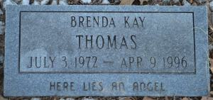A gravestone reading, Brenda Kay Thomas. July 3, 1972 to April 9, 1996. Here lies an angel.