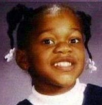 Photo of Talia Williams, a young girl in pigtails decorated with plastic barrettes.