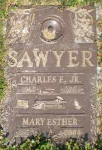 A gravestone reading, Sawyer, Mary and Charles, together forever.