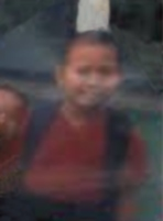 Blurry, somewhat distorted photo of Sze-ming Chan, a small boy wearing a backpack.
