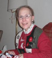 Photo of Monica Schemm, a woman in a Christmas sweater.