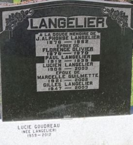 "A gravestone for the Langelier family, reading in part, ""Lucie Goudreau, nee Langelier, 1959-2012."" The inscription is carved onto the base of the headstone, implying that it was an unexpected addition that would not fit onto the main headstone."