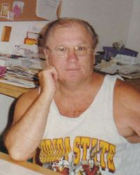 Photo of John Pehota, a balding man in a sports-themed sleeveless shirt and glasses.