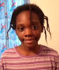 Photo of Janiya Thomas, an African-American girl wearing a striped shirt.