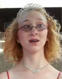 Photo of a teenage girl. She is wearing a jeweled necklace and thick glasses, and there is a tiara atop her frizzy blonde hair.